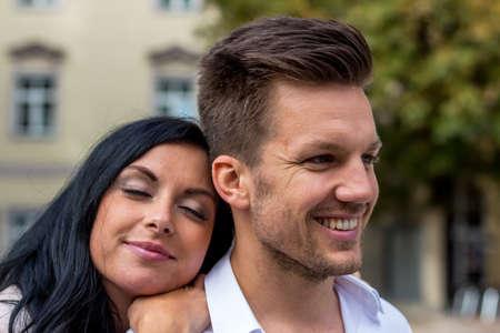 vivre: a couple having fun in a city walk