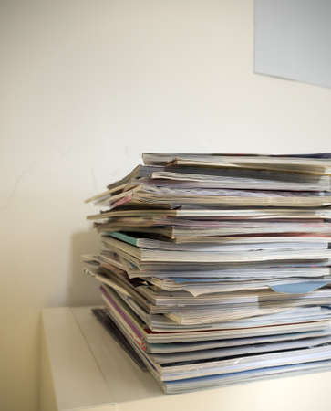 aktenstapel in an office. brochures and files waiting for processing.