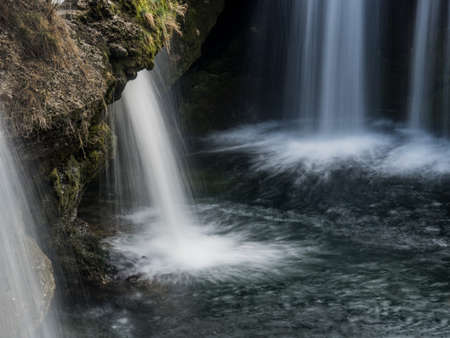 water flows over a waterfall. beauty of nature