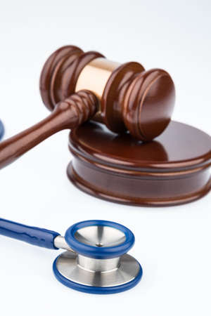 physicans: gavel and stethoscope, symbol photo for bungling and doctors error