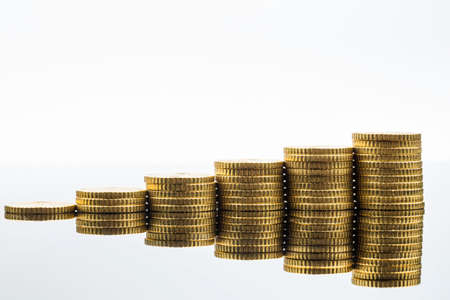 financial symbol: stacked coins ascending series, symbol photo for financial planning, increasing yield and good return