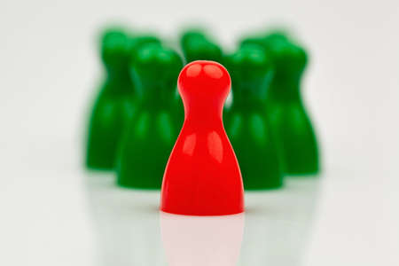 manager team: red and green pawns. manager and leader of the team. Stock Photo