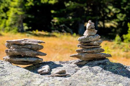 meditation help: successive stacked stones, symbolizing hiking, marking, orientation