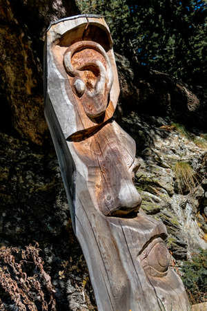 senses: carving tree trunk senses, symbolizing hearing, smell, sight