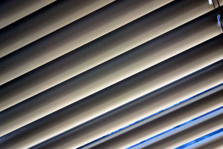 lamellar: to protect against heat and sun blinds are attached to a window. Stock Photo