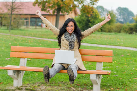 wlan: a man with a laptop sitting on a park bench Stock Photo