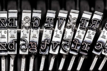 illiteracy: types and characters of an old typewriter. symbol photo for communication in earlier times