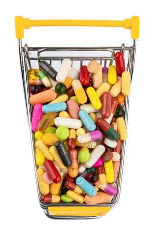 studied: tablets with shopping cart. symbol photo for the purchase of medicines on the internet Stock Photo