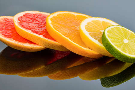 lemon slices: slices of an orange. symbol photo for healthy vitamins with fresh fruit Stock Photo