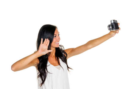 memoirs: a young woman has fun while they themselves photographed with an old camera. selfie