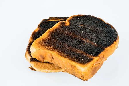 toast bread: toast was burned during toasting. burnt toast at breakfast. Stock Photo