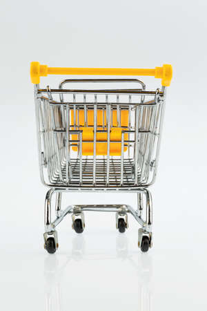 grocers: an empty shopping cart on white background. symbol photo for shopping