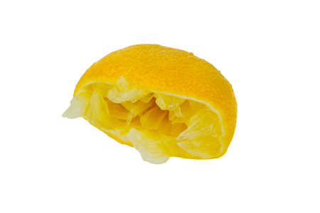 a squeezed lemon on a white background. symbol photo for taxes and fees.