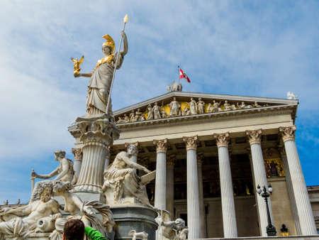 greek goddess: parliament in vienna, austria. with the statue of the pallas athene the greek goddess of wisdom.