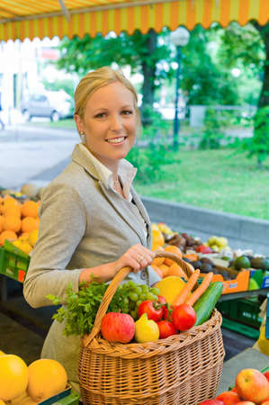 woman diet: a young woman buying fruits and vegetables at a market. freshness and healthy diet. Stock Photo