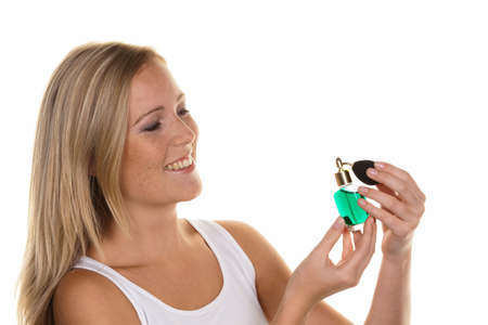 nursing bottle: a young woman with a bottle of perfume personal hygiene and cosmetics