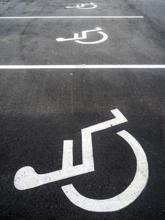 pkw: a wheelchair is mounted on a car park for handicapped. Stock Photo
