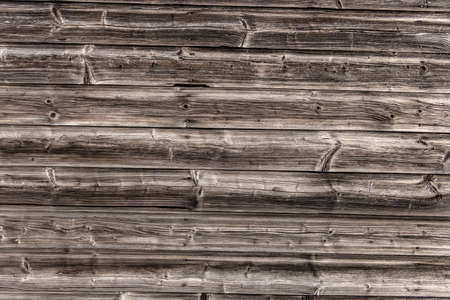 knothole: a wooden wall of old boards built. concept photo for hinterg?nde