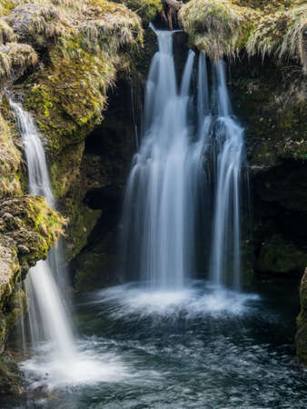 hydroelectricity: water flows over a waterfall. beauty of nature