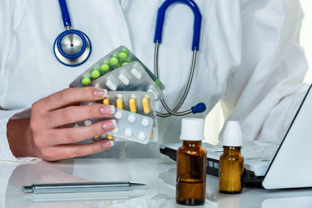 physicans: a doctor issues a prescription for medication. prescription pills from the pharmacy.