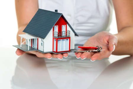 broker's: an agent for property with a house and a key. successful leasing and property sales by real estate brokers. Stock Photo
