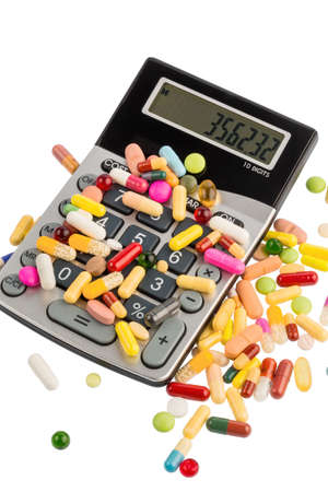 therapie: tablets lie on a calculator. symbol photo for costs in medicine and pharmaceutical industry