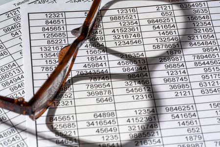 examiner: a table with the figures of revenue and expenditure. symbol photo for kosetn, profit, controlling Stock Photo