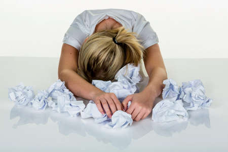 overwhelmed: young woman in office is overwhelmed with work. burnout at work or study.
