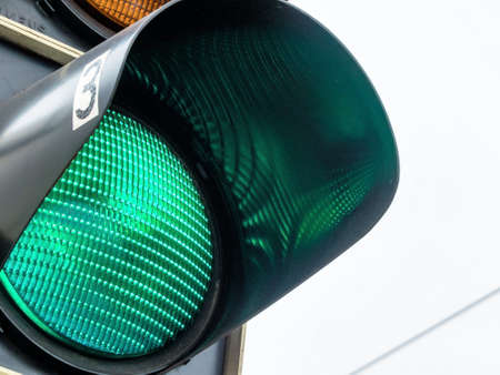 regulate: at a traffic light green light. symbol photo for launch and success.