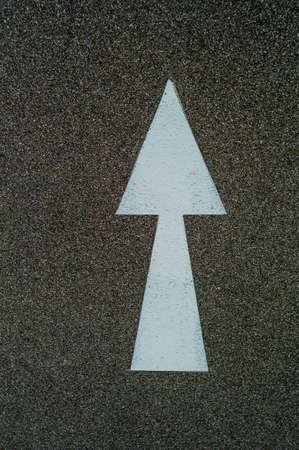 marked down: arrow as directional marker on a bike path in linz, austria