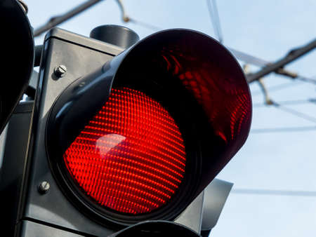 standstill: a traffic light on the road shows red light.
