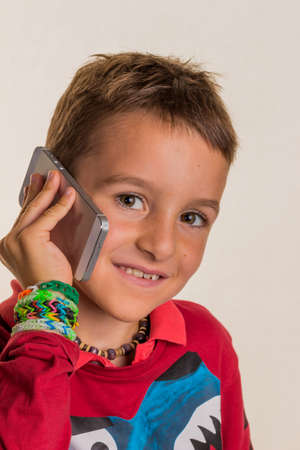 roaming: one child phoning with a mobile phone.