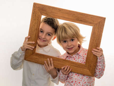 standpoint: a child holds a frame in her hand and looks through.
