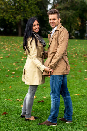 a young, laughed liebtes couple in a park Stock Photo