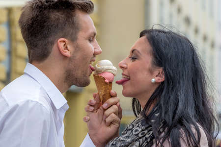 leis: a young couple with a bag of ice. ice cream cones as summer refreshment Stock Photo