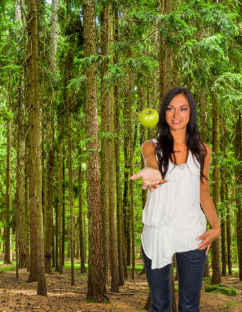 joie: many trees in a forest with fresh green and a woman with an apple Stock Photo