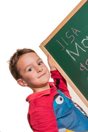 alumni: one child writes the word mom on a blackboard Stock Photo