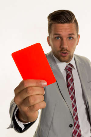 admonition: ein manager holds a red card in hand. symbol photo for resignation or dismissal Stock Photo