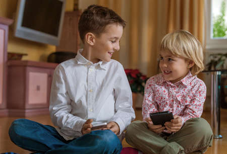 holydays: a child playing with a cell phone. mobile phone for kids