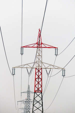 energy needs: poles of a high voltage line for power. power line for energy. Stock Photo