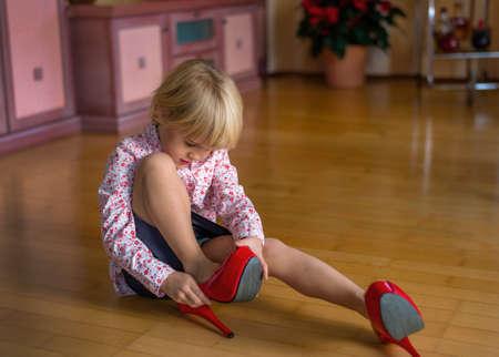 vivre: a kind tasted the big shoes of an adult. symbol: living on large feet.
