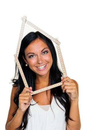 immobilien: a young woman wants to build a house Stock Photo