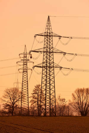 curren: poles of a high voltage power line. production and transport of energy.