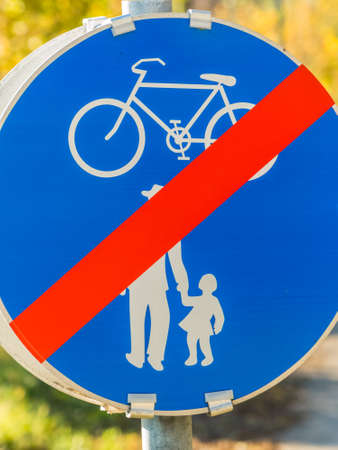 velo: sign for bike path and walkway. impact on road Stock Photo