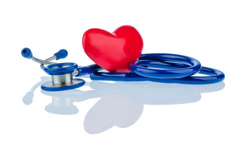 arrhythmias: a heart and a stethoscope are adjacent. symbol photo for heart disease and heartache. Stock Photo