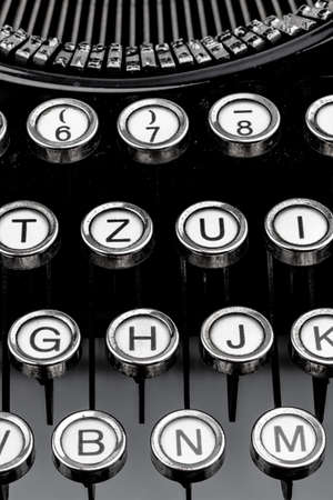 illiteracy: keys of an old typewriter. symbol photo for communication in earlier times