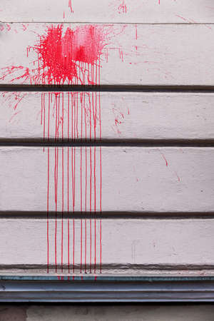building wall: red ink splashes on a wall, a symbol of red, criminal damage, vandalism