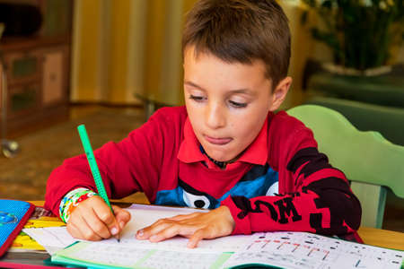general knowledge: a student doing his homework. schoolwork be made. Stock Photo