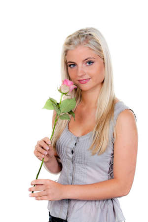 young woman with a rose on the smells. photo