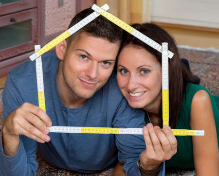 single familiy: a young couple is looking forward to the construction of a detached house